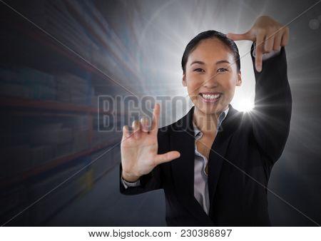 Digital composite of Businesswoman making angular shape