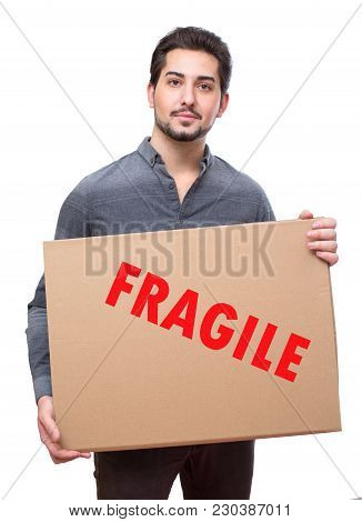 Young Ma Holding Fragile Cardboard Shipment, Dign On The Box