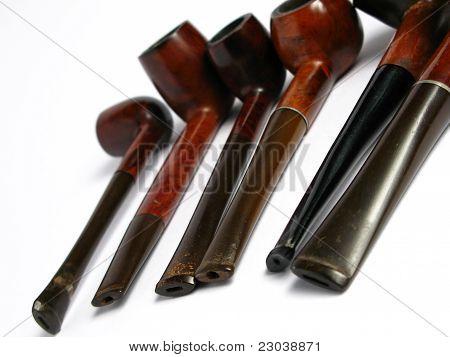 Many Elegant wood Pipe on white background