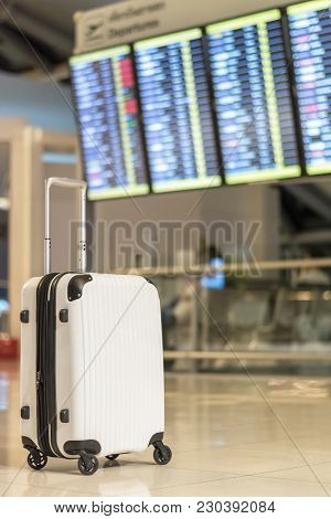 Travel Luggage Suitcase At The Airport Terminal In Waiting Area For Departure Flight For Business Tr