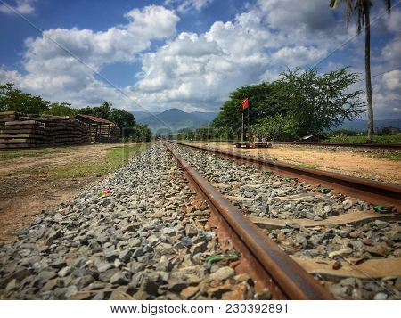 Looking South Along The Cambodia Railway Tracks From Kampot Leading To The Coast.  Mount Bokor Beaco