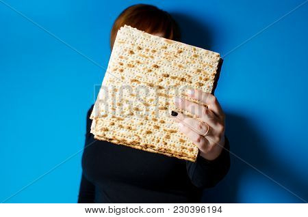 A Young Girl Holds A Traditional Meal Of Matzo In A Family Holiday Pesah