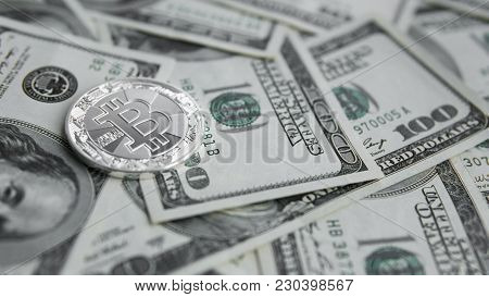 Silver Bitcoins On Us Dollars. Digital Currency Close-up. Virtual Money. Crypto Currency. Metal Coin
