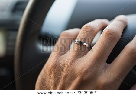 Car Driver Hands Holding Steering Wheel.car Driver Hands Holding Steering Wheel.