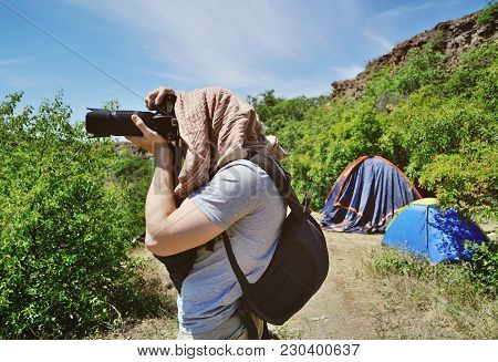 A Photographer Of Wildlife In Arafatka Takes Pictures Of The Landscape On The Background Of A Touris