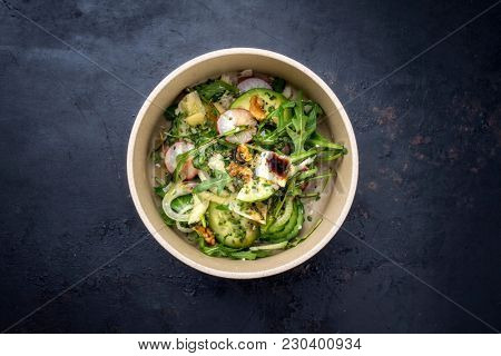 Traditional Germen lettuce with rocket salad and vegetable as top view on a plate with copy space