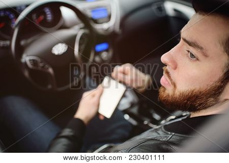 Drunk Driver Driving A Car. Driving In A State Of Intoxication.young Man Driving A Car With An Iron