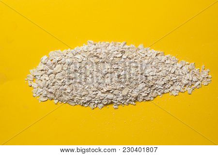 Oatmeal Flakes For Health. Vegetarian Food For Breakfast On A Colored Background. Organic Product