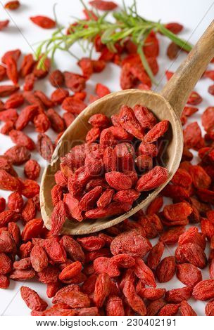 spoon of healthy goji berries on goji berries background