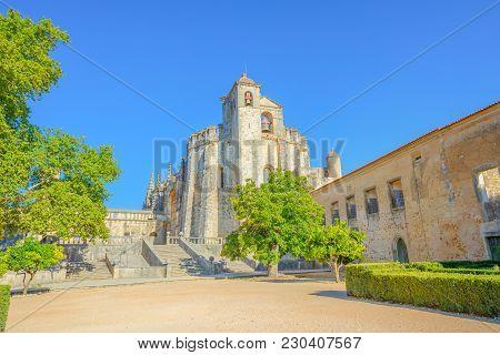 Church Of Convent Of Christ Or Convento Dos Cavaleiros De Cristo, In Tomar, Portugal. Sunny Day, Blu