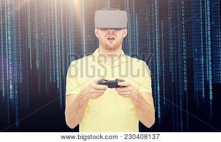 3d technology, virtual reality, entertainment and people concept - happy young man with virtual reality headset or 3d glasses playing with game controller gamepad over binary code background