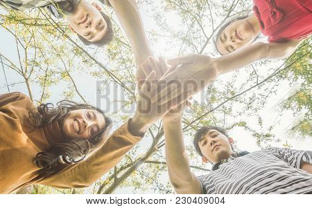 Asian College Students Teamwork Stacking Hand Concept