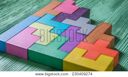 The Concept Of Logical Thinking. Geometric Shapes On A Wooden Background.  Colorful Toy Wooden Block