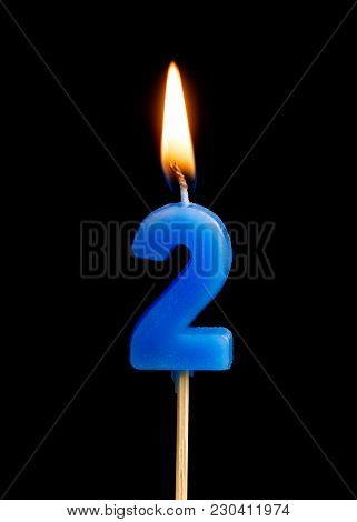 Burning Candle In The Form Of Two Figures (numbers, Dates) For Cake Isolated On Black Background. Th