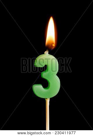 Burning Candle In The Form Of Three Figures (numbers, Dates) For Cake Isolated On Black Background.