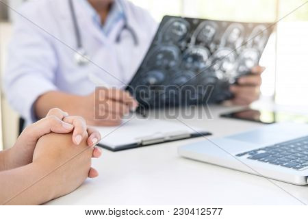 Professor Doctor Report And Recommend A Method With Patient Treatment, Results On Brain X-ray Film A