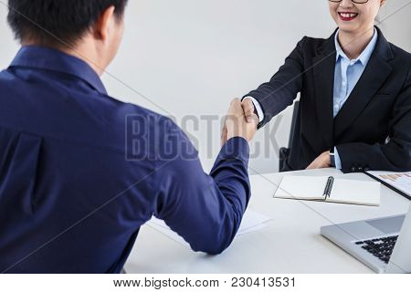 Finishing Up A Meeting, Business Handshake After Discussing Good Deal Of Trading Contract For Both C