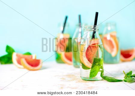 Pink Grapefruit And Fresh Basil Infused Drink  In Bottles, Spa Fruit Water, Or Summer Party Alcoholi
