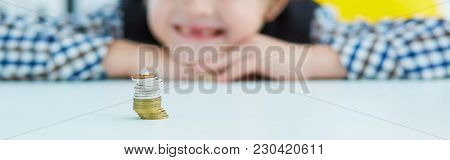 Smiling Young Boy With Missing Front Tooth. Pile Of Coins With A Baby Tooth On Top. Tooth Fairy Givi