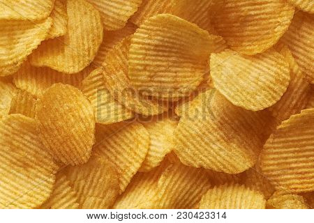Background Corrugated Golden Chips With Texture Close Up