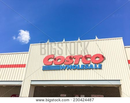 Close-up Logo Of Costco Wholesale Store At Facade Entrance