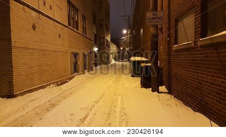 Snow Covered Back Alley In Winter, Road, Tire Tracks, Dark,