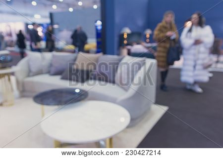 Buyers In The Furniture Store. Blurred Background