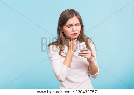 Sore Throat. Woman Touching The Neck On Blue Background.