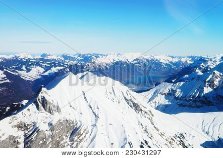 The Center Of Bernese Apline Town Of Interlaken At Winter Swiss Alps, Helicopter View. Brienz Lake O