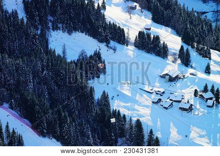 Aerial View On Flying Helicopter And Small Village In Bernese Oberland In Switzerland.