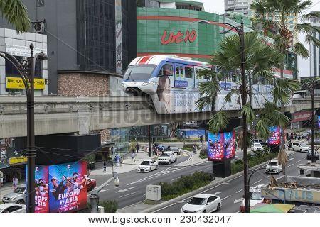 Kuala Lumpur, Malaysia - December 31,2017 : Kl Monorail Train Passing Through Lot 10 Mall At Bukit B