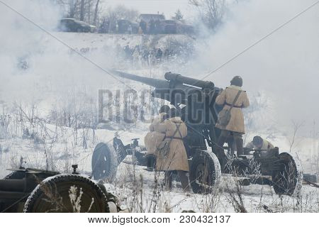 Krasnoe Selo, Russia - January 14, 2018: A Team Of Anti-aircraft Artillery Guns Fire At Ground Targe