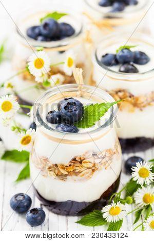Greek Yogurt With Blueberries And Granola Parfait. Selective Focus.