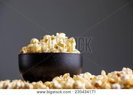 Popcorn In An Exquisite Ceramic Bowl And Around It.