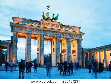 Berlin, Germany - December 13, 2017:  People At Brandenburg Gate In The Center Of Berlin In The Even