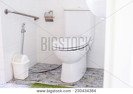 White Modern Toilet Bowl In A Bathroom,water Closet