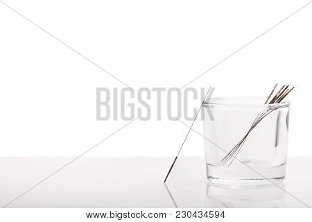 Silver Needles For Traditional Chinese Medicine Acupuncture. Close-up. White Background. There Is So