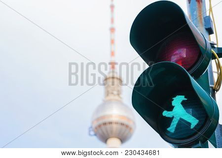 Berlin, Germany - December 10, 2017: Green Traffic Light And Television Tower On The Background In B