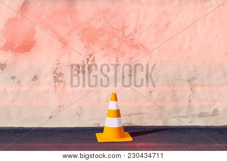 3d illustration of a traffic cone on a wall