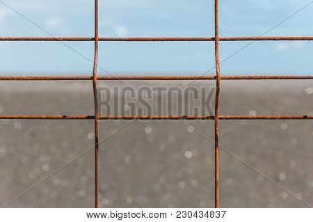 Iron Fence With Corrosion Before Horizon Close-up.