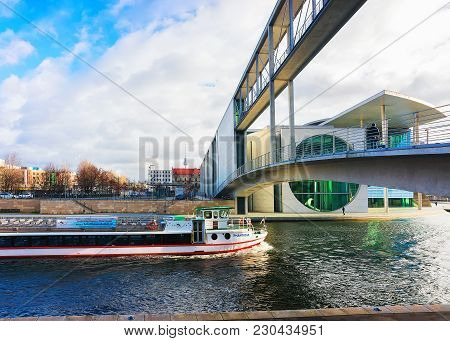 Berlin, Germany - December 8, 2017: Excursion Boat At The Bridge At German Bundestag Parliament Buil