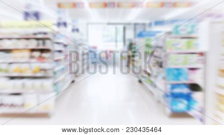 Supermarket Aisle With Colorful Shelves And Many Products As Blurred Background