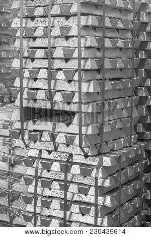 Close Up Of Aluminum On Pallet Ingot Storage In Indoor Warehouse For Export As Industrial Background