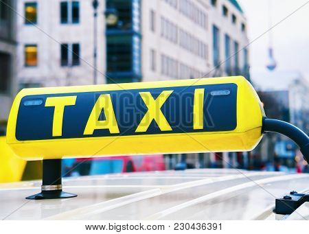 Taxi Sign Board In The Street Of Berlin, Germany. Television Tower On The Background