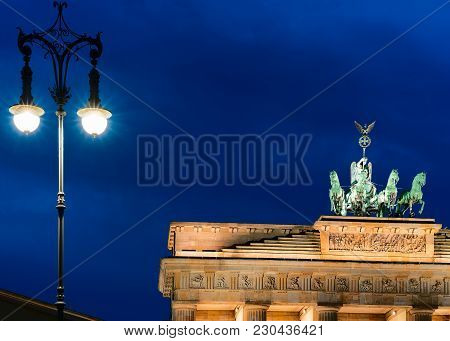 Street Lamp And Brandenburg Gate In The Center Of Berlin Late In The Evening, Germany