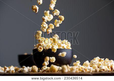 Levitating Popcorn Around A Ceramic Bowl.