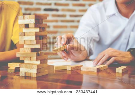 Group Of Business Creative People Building Tower By Wooden Blocks, Doing A Plan For Brainstrom Busin
