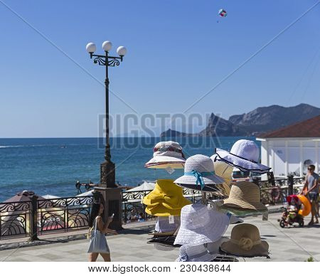 Sudak, Crimea - September 9, 2017: A Hanger With Female Summer Hats In A Store On The Waterfront Of