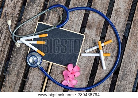 Healthy And Medical Concept Image Of Signage, Stethoscope And Cigarette Layout On Wooden Background