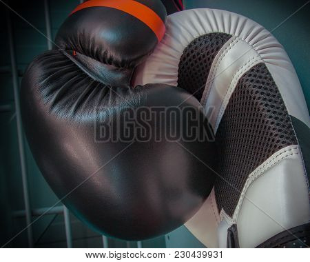 Black And White Boxing Gloves On A Grey Construction